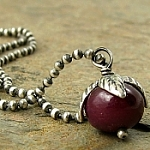 necklace with smooth ruby gemstone & oxidized sterling silver. cerise